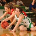 Haley Maxwell, left, a Farmington junior guard, and Greenland senior guard Morgan Miller vie for a l...