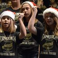 "Farrah Russo, 12, left, Alexys Roland, 12, right, and Mackenzie Mason, 12, top, perform a ""Santa Cla..."