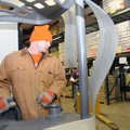 Grant Brand, warehouse supervisor at the Northwest Arkansas Food Bank, reorganizes the freezer Tuesd...