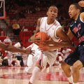 Arkansas sophomore guard BJ Young drives to the lane as Robert Morris junior guard Caron Williams ap...