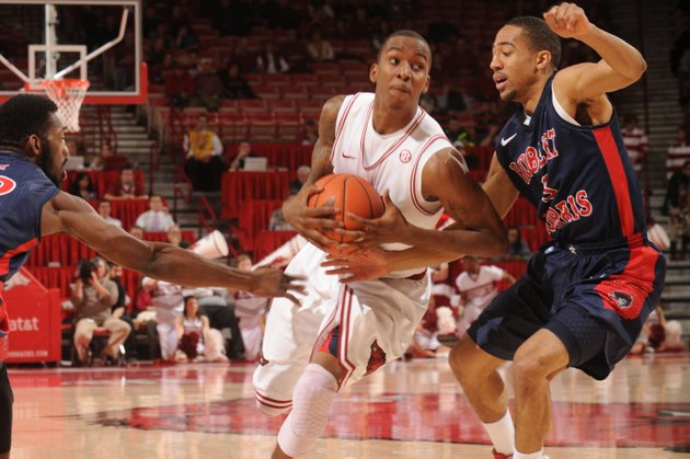 arkansas-sophomore-guard-bj-young-drives-to-the-lane-as-robert-morris-junior-guard-caron-williams-applies-pressure-during-the-first-half-thursday-dec-20-2012-in-bud-walton-arena-in-fayetteville