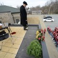 Michael Poore, superintendent of Bentonville Schools, listens Wednesday from the roof of the School ...