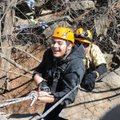 Jonathan Barrientos, a Rogers High School student with cerebral palsy, rappels down a cliff with out...
