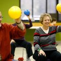 Jutta Shipley (left) of Springdale exercises Wednesday with the class.
