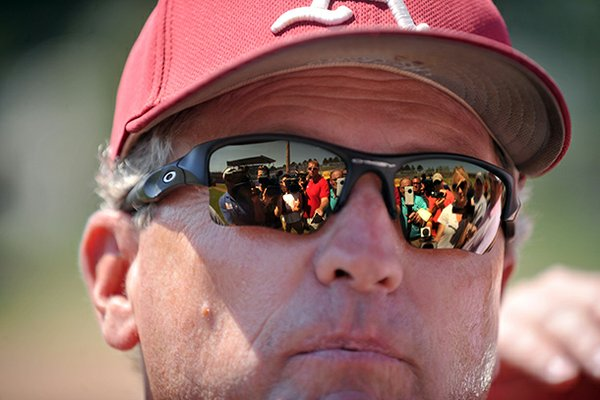 The road back to Omaha will have to go through Manhattan, Kan. for Dave Van Horn and the Arkansas baseball team.