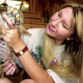 Tanya Smith, one of the founders of Turpentine Creek Wildlife Refuge near Eureka Springs, greets a n...