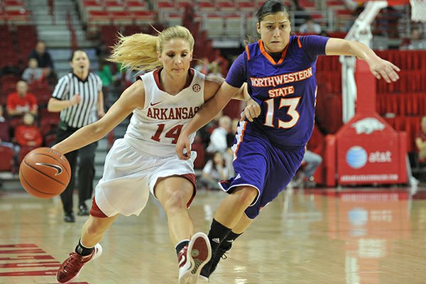 NWA Media/MICHAEL WOODS --12/21/2012-- Arkansas' Erin Gatling tries to get the ball past Northwestern State defender Janelle Perez as she drives to the hoop in the first half of Friday night's game at Bud Walton Arena in Fayetteville.