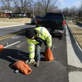 Brady Burcham of Time Striping removes the final roadblock Thursday to open the newly upgraded secti...
