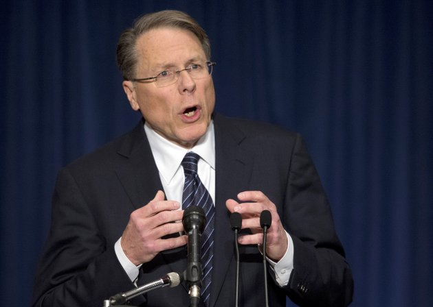the-national-rifle-association-executive-vice-president-wayne-lapierre-gestures-during-a-news-conference-in-response-to-the-connecticut-school-shooting-on-friday-dec-21-2012-in-washington-the-nations-largest-gun-rights-lobby-is-calling-for-armed-police-officers-to-be-posted-in-every-american-school-to-stop-the-next-killer-waiting-in-the-wings