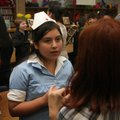 Gabriella Arroyo, a sixth-grader, recounts Thursday the story of Monica Benning, a nurse on duty dur...