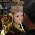 Robert Townsend, a sixth-grader, plays a note Thursday in his role as Titanic band leader during the...