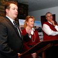 Brian Hooper, from left, Walmart vice president of real estate, property owner Robin Lundstrum and M...
