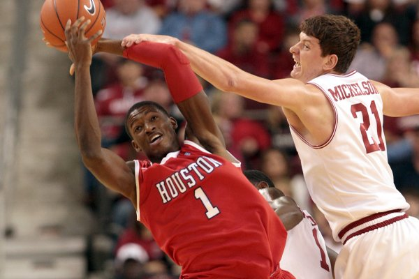 Sophomore forward Hunter Mickelson, who scored a career-high 16 points against Robert Morris, said the players understand they need to stay sharp tonight. Mickelson blocks a shot during Arkansas' game against Houston last November at Verizon Arena. The Razorbacks have lost three straight games in North Little Rock.