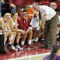 Arkansas women's Coach Tom Collen talks with his team during the first half of Friday's game against...