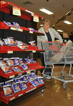 Faye Crawford passes a rack of Hostess products on Nov. 24 at a grocery store in Jonesboro.
