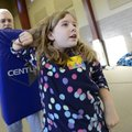 Avery Pick, 9, center, throws an elbow into a striking dummy Thursday held by Benton County Sheriff'...