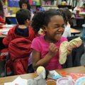Samaria Hall, 6, gets excited about the gifts she received in a stocking Friday in her kindergarten ...