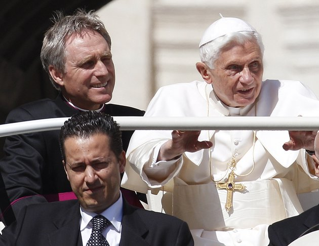 in-this-file-photo-taken-wednesday-may-2-2012-pope-benedict-xvi-right-arrives-in-st-peters-square-at-the-vatican-for-a-general-audience-as-his-then-butler-paolo-gabriele-bottom-and-his-personal-secretary-georg-gaenswein-sit-in-the-car-with-him-the-vatican-has-summoned-journalists-for-a-briefing-on-saturday-dec-22-2012-for-what-italian-media-report-is-expected-to-be-the-announcement-of-a-pardon-for-the-former-butler-gabiele-who-was-convicted-in-october-2012-of-aggravated-theft-after-steeling-the-pontiffs-personal-papers-and-leaking-them-to-the-media-in-a-bid-to-expose-the-evil-and-corruption-in-the-catholic-church