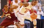 Arkansas Democrat-Gazette/STEPHEN B. THORNTON -- Alabama A&M's Green Hill, left, and Arkansas' BJ Young battle for a loose ball after Young stripped it during the first half of their game Saturday night at Verizon Arena in North Little Rock.