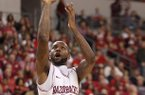 Arkansas' Marshawn Powell drives to the basket in the second half against Alabama A&M's Saturday night at Verizon Arena in North Little Rock. He finished with 20 points.