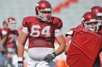 Arkansas center Travis Swanson, a three-year starter, would be the only returning Razorbacks' offensive lineman with All-SEC honors if he returns for his senior season.