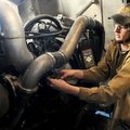 Jacob Little with the diesel technology class at Northwest Technical Institute in Springdale checks ...
