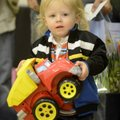 Jacob Simpson, 20 months, of Sulphur Springs carries the toy truck he picked out. Jacob attended wit...