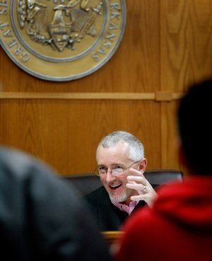 Ernest Cate, Springdale District Court judge, speaks Thursday to people appearing in the court.