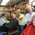 Richard Howk, right, gets a trim from barber Gary Townzen on Saturday during Townzen's annual charit...