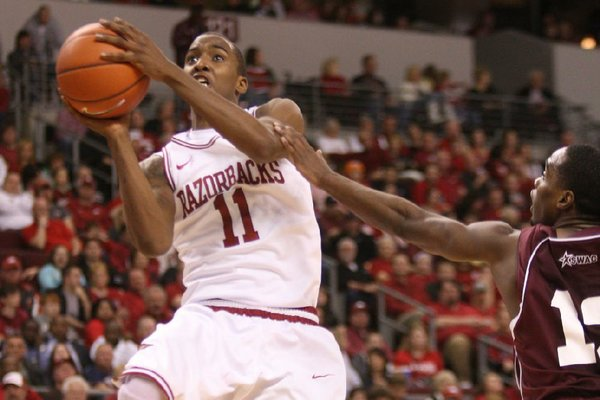 Arkansas' BJ Young drives to the basket  against Alabama A&M's Green Hill during the second half Saturday, Dec. 22, at Verizon Arena in North Little Rock. He finished with 13 points and a career-high 9 assists.