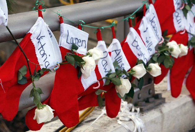 file-in-this-wednesday-dec-19-2012-file-photo-christmas-stockings-with-the-names-of-shooting-victims-hang-from-railing-near-a-makeshift-memorial-near-the-town-christmas-tree-in-the-sandy-hook-village-of-newtown-conn-in-the-wake-of-the-shooting-the-grieving-town-is-trying-to-find-meaning-in-christmas-ap-photojulio-cortez-file