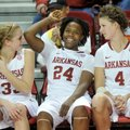 Arkansas players Melissa Wolf, Quistelle Williams and Sarah Watkins relax on the bench for the final...