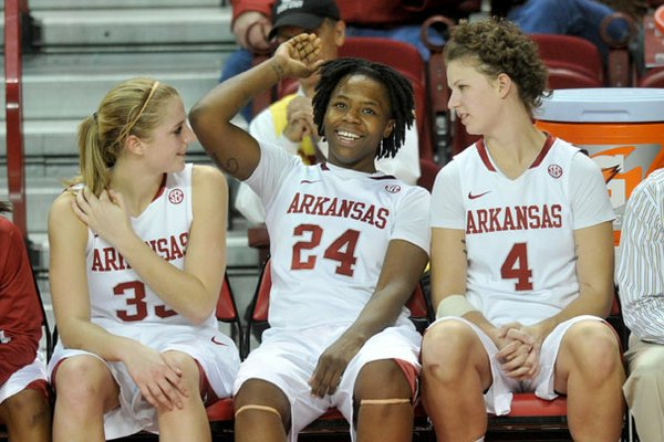 Arkansas players Melissa Wolf, Quistelle Williams and Sarah Watkins relax on the bench for the final minutes of their 80-41 win over Northwestern State on Friday, Dec. 21, at bud Walton Arena in Fayetteville.