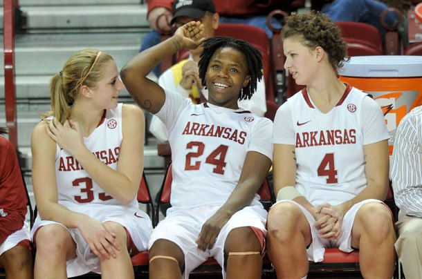 arkansas-players-melissa-wolf-quistelle-williams-and-sarah-watkins-relax-on-the-bench-for-the-final-minutes-of-their-80-41-win-over-northwestern-state-on-friday-dec-21-at-bud-walton-arena-in-fayetteville