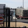 A truck drives onto scales Tuesday at the Tyson Foods Berry Street plant in Springdale. While factor...