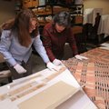 Carolyn Reno (left), collections manager with Shiloh Museum of Ozark History, and Marty Benson, a me...
