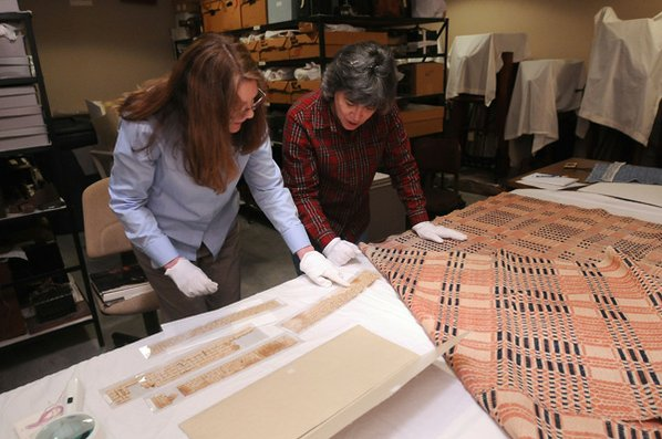 Carolyn Reno (left), collections manager ...