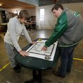Tanner Wilson, left, and Brandon Fulton, Greenland High School juniors, take a look at the plans for...
