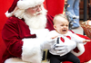 Nine-month-old Carter Chance isn't too happy about having her photo made with Santa Claus at Park Plaza Mall on Monday afternoon.  Afternoon crowds for last minute shoppers was a little lighter than normal at Park Plaza.