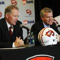 New Western Kentucky head coach Bobby Petrino, left, responds to a question as athletic director Tod...