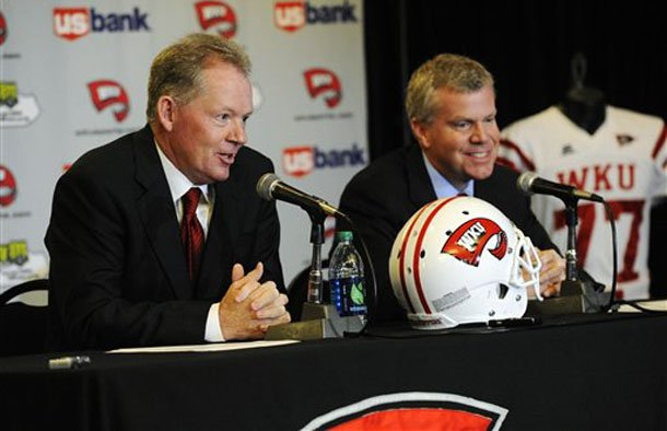 new-western-kentucky-head-coach-bobby-petrino-left-responds-to-a-question-as-athletic-director-todd-stewart-smiles-during-an-ncaa-college-football-news-conference-monday-dec-10-2012-in-bowling-green-ky-the-51-year-old-was-fired-by-arkansas-in-april-for-a-pattern-of-misleading-behavior-following-an-accident-in-which-the-coach-was-injured-while-riding-a-motorcycle-with-his-mistress-as-a-passenger-but-now-wants-to-make-the-most-of-his-second-chance-ap-photothe-daily-news-joe-imel