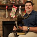 Jonathan Luigs, former University of Arkansas football player, won the Rimington Trophy as a Razorba...