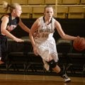 Taylor Lee, above right, Bentonville, drives the ball around Gravette's Kylee Davis during the Crabt...