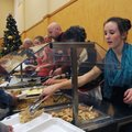 Meredith Hedberg, right, serves turkey on Tuesday during the Central United Methodist Church of Roge...