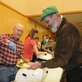 Ed Grames, left, serves a traditional Christmas dinner to John J.C. Colbert on Tuesday at Central Un...