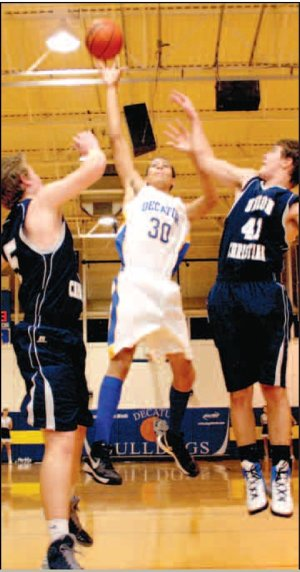 Decatur senior, forward Andrew Harris goes up for two against Union Christian Academy's Joel Murdock (41) and Braxton Smith (5) during play in the Lloyd Peterson Gymnasium at Decatur on Dec. 18.
