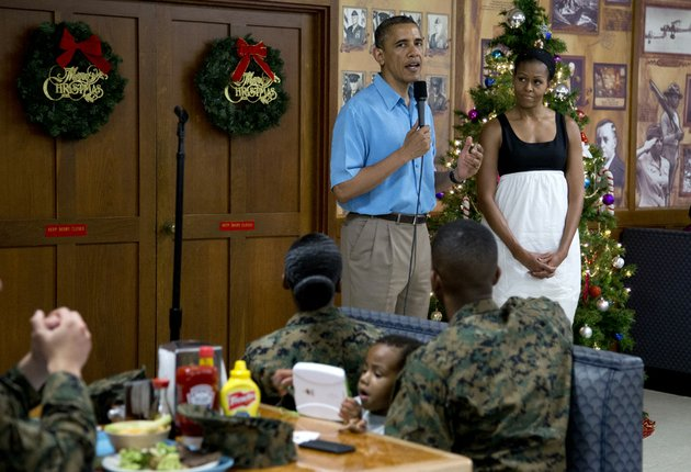 president-barack-obama-speaks-as-first-lady-michelle-obama-listens-during-a-visit-with-members-of-the-military-and-their-families-in-anderson-hall-at-marine-corp-base-hawaii-on-tuesday-dec-25-2012-in-kaneohe-bay-hawaii-the-first-family-is-in-hawaii-for-a-holiday-vacation