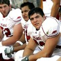 Arkansas center Jonathan Luigs looks toward the scoreboard during the fourth quarter against Texas S...