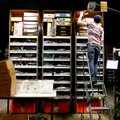 Eric Nix pulls products for an order for CountryOutfitter. com in the warehouse of Acumen Brands on ...