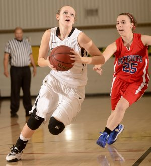Bentonville's Taylor Lee, left, drives past East Newton (Mo.) defender Whitney Thomlinson on Wednesday during the Neosho (Mo.) Holiday Classic in Neosho, Mo.